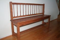 Old crib repurposed to a bench, very pretty!