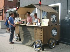 https://flic.kr/p/8fu9Yu   Portable Coffee Shop, Brooklyn   Get this; they can fold this all up so it fits on  two bikes.  The name:  Kick Stand.
