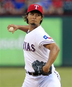 Texas Rangers starter Yu Darvish throws a pitch during the first inning of a baseball game against the Los Angeles Angels on Wednesday, Aug. 1, 2012, in Arlington, Texas. (AP Photo/John F. Rhodes)