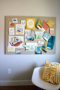 Next to my kitchen... this would look PERFECT! Ali, I have a project for you and me next time you come over!!!!  {Sophisticated linen covered cork board. I love how the nailheads make it look high end.}