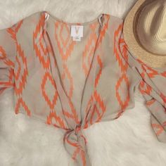 Size Small Chiffon Tie Crop Top Size small tan and orange designed crop top with adjustable tie. Tops Crop Tops