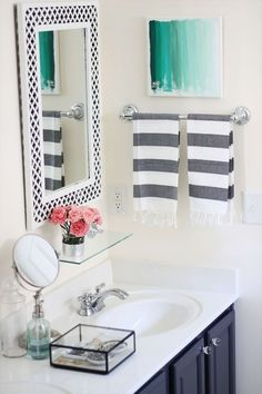 Grey & White Bathroom with a splash of color. Guest bath?