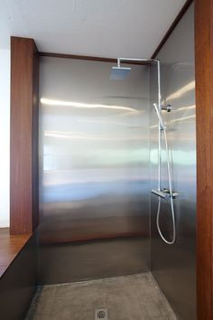 stainless steel walk in shower. would do the fixtures differently, but I love the simplicity.