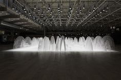 """NENDO, 80 SHEETS OF MOUNTAINS 2013: """"laser-cut and stretched 80 sheets of 5mm polystyrene into a set of partitions shaped like mountains."""""""