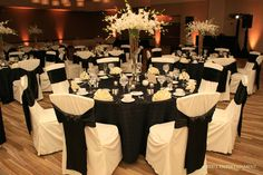 black tablecloths, white chair covers                                                                                                                                                      More