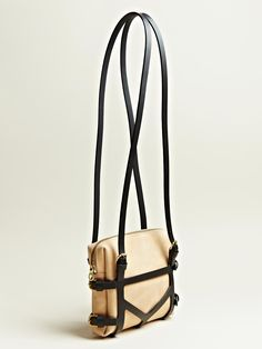 Harnessed Bag. Remove the harness to use as a clutch.