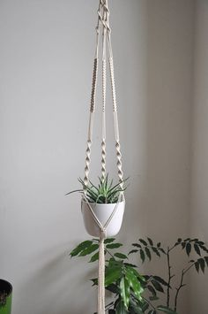 Macrame plant hanger with different knots. Hanging plant holders are great way to add some greenery into you home. Perfect as a housewarming gift for any plant lover. Hot trend!   READY TO SHIP > Only one unique piece - made with pure joy of creation - whole section https://tinyurl.com/y8c847fp >> color: natural cotton/ecru/beige/linen  >> measurements: (this listing is for the macrame plant hanger only, does not include plant or pot)  white small ...