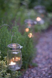 Karin Lidbeck: Garden Light--jars, votives, and stands/racks.