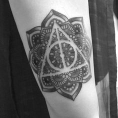 Harry Potter Tattoo: new top 100 idea in the world | Some weird triangle logo thing in a mandala, I think it's something to do with the illuminati?