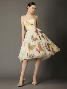 Butterfly dress. Makes us want to have a garden party now!