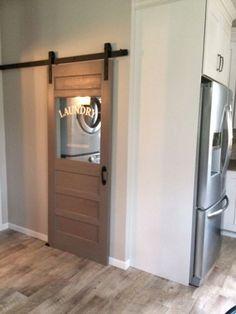 Hidden behind a rustic laundry room sliding door
