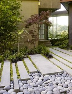| P | A unique garden and entry way path using concrete and giant river rock.