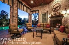 Outdoor lounge in back of House Plan 36226TX built in Texas