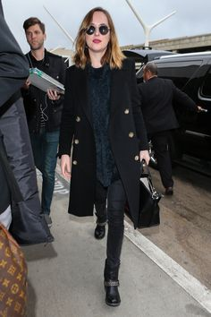 Dakota Johnson Rocks What Might Be the Coolest Boot for Winter Travel