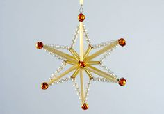 Beaded Snowflake PATTERN, not in English, but with diagram - Click the link after name - PDF for each picture.