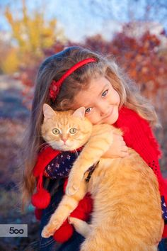 Little girl holding a big red cat by Myra Lypa on 500px