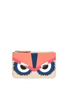 Add a playful tone to your daily portfolio with Fendi's crystal-embellished Bag Bugs cardholder. It's crafted from cream saffiano leather with coral, fuchsia, navy and black depicting the monster's eyes. Keep credit and business cards safe within the zip-fastening top.