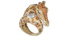BOUCHERON. Giraffe ring. Yellow gold with white, brown and orange diamonds, orange and blue sapphires.