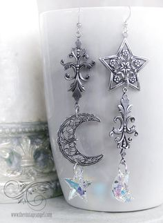 Extra long, dangly asymmetrical show stoppers with celestial flair! These beauties are nearly 4