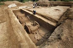 To protect it from drying out, a worker sprays water onto a millennia-old chariot recently unearthed in the city of Luoyang (map) in central China.  Overall, 5 chariots and 12 horse skeletons were found in the tomb pit, according to China's state-sponsored Xinhua news service. Archaeologists believe the tomb was dug as part of the funeral rites of a minister or other nobleman during the Eastern Zhou dynasty period, about 2,500 years ago.