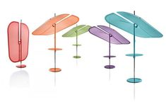 12 Umbrellas We'd Be Happy to Sit Under \\\ The Nenúfar parasol from Samoa Design mimics the shape of a water lily leaf. It comes in bright colors and the design tilts so you can angle the shade however you like for the most protection.