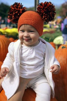 A super easy and exciting pom pom hat for both kids and adults! Find this adorable Thanksgiving pattern at LoveKnitting.Com.