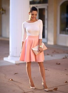 coral skirt with envelope clutch and nude pumps