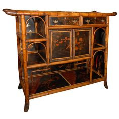 English Bamboo Console Cabinet with Lacquered Doors | From a unique collection of antique and modern cabinets at https://www.1stdibs.com/furniture/storage-case-pieces/cabinets/