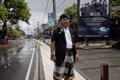 Balinese guard known as 'Pecalang' patrols on a street during the observation of 'Silence Day' on March 12, 2013 in Denpasar, Bali, Indonesia.