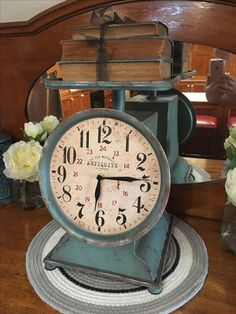Click scales in turquoise atop our antique sideboard