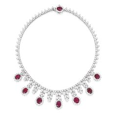 Platinum, White Gold, Ruby and Diamond Necklace  Set with eight oval-shaped rubies weighing approximately 22.00 carats, accented by round, pear and marquise-shaped diamonds weighing approximately 42.35 carats, length 16½ inches.