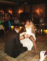 The best man, inspecting the goods. This is my kind of wedding photo! I wonder who gets to fuck the bride first?