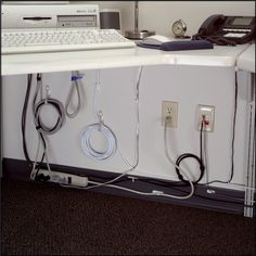 Stop tripping over cords and get your office space organized! Use Command™ Cord Organizers to keep cords tucked away. Cord Organization, Classroom Organization, Rental Solutions, Rental Decorating, Decorating Ideas, Garage, Command Strips, Organizing Your Home, Helpful Hints