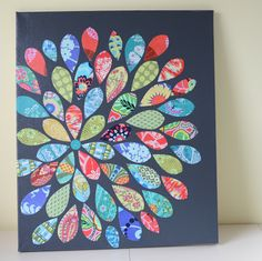 Fabric leaves decoupaged onto a painted canvas board