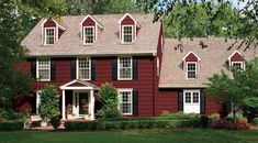 Colonial Red Wins... With black barn style shutters