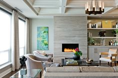 """gray veined stone (Marble slabs from Ann Sacks surround the fireplace. Athens Silver Cream 30"""" x 72"""")"""