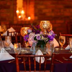 Mercury Glass Wedding Centerpiece with lavender hydrangea, lavender roses, dark purple stock and fuchsia stock