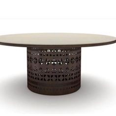 'Dogon T' by Emmemobili  Tables – round or oval – with the base done by a single flexible sheet of plywood, decorated with laser fretworks. www.essessltd.com