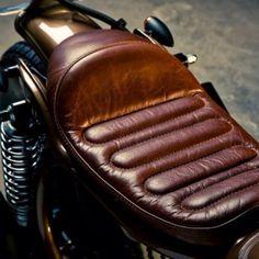 beardbrand: Leather motorcycle seat.