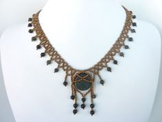 DIY Jewelry: FREE beading pattern for Tribal Net necklace, featuring caged 20mm flat round natural stone as the center component, adorned with fringed drops