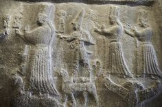 Hittite relief sculptures of Gods at the Yazilikaya Sancutary [ i.e written riock ], Hattusa, Turkey.  The largest known Hittite sanctuary. 12th - 13th century BC made in the reign of Tudhaliya 1V . Plastercast at the Vorderasiatisches Museum, Pergamon Museum, Berlin.
