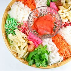 Yee Sang is a raw fish salad and a must-have for the Chinese New Year Feast. Make it at home using lox and a variety of crunchies and vegetables.
