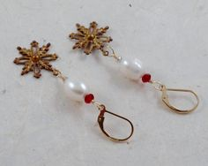 Vintage Snowflake earrings, with snow white pearls and red Swarovski crystals on 14k gold filled ear wires. by ChrisAllenJewelry on Etsy