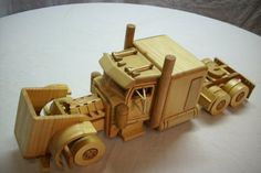 Truck with all the extras, observe the eight cylinder engine is built with pinw wood only. Wood Toys Plans, Home Blogs, Wooden Truck, Tools For Sale, Dust Collection, Peterbilt, Kids Toys, Children's Toys, Home Projects