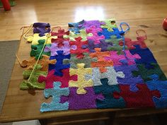 puzzle pieces afghan, wonderful! - this might just be enough to make me learn to knit - @Katie Oneil