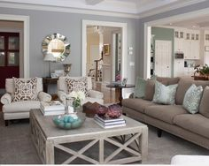 Pillows!! cream and blue living room! Nice room. How To Make Your Home Look Like You Hired An Interior Designer