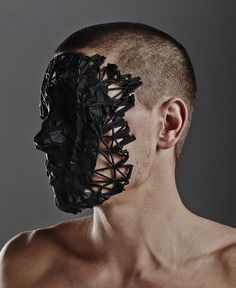 Photograph of 'Oracle' mask sculpture worn by a model.