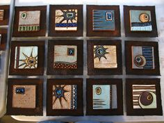 [Finished-art-nouveau-inspired-tile-plaques-clay-and-slumped-glass-bullseye-fused-glass.JPG]
