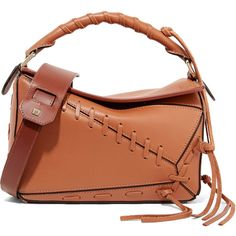 Loewe Puzzle small whipstitched textured-leather shoulder bag ($2,450) ❤ liked on Polyvore featuring bags, handbags, shoulder bags, light brown, brown crossbody, shoulder bag purse, tassel handbag, cross-body handbag and cross body cell phone purse