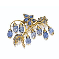 18 KARAT GOLD AND SAPPHIRE BROOCH, RENÉ BOIVIN, 1953 Designed as a leafy branch bearing pendants of 8 flexibly-set cabochon sapphire blossoms, the leaves set with additional cabochon sapphires and round faceted sapphires, completed by rose-cut diamonds on the stem, French assay marks.